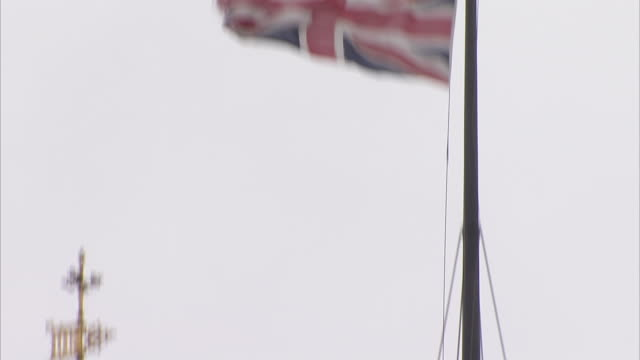 The Union jack flies high above the Victoria Tower in London England. Available in HD.