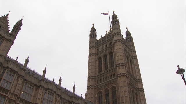 The Union Jack flies high over Victoria Tower in London England. Available in HD.