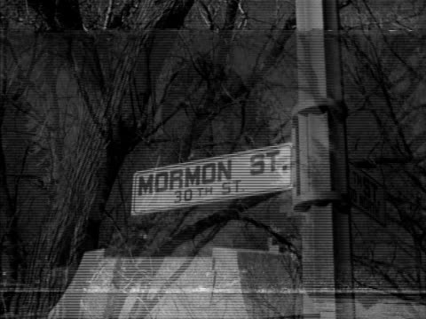 The Union Station 'Mormon St' sign Mormon Pioneer Cemetery monument statue PAN of Omaha cityscape bull head hanging in historical museum NE