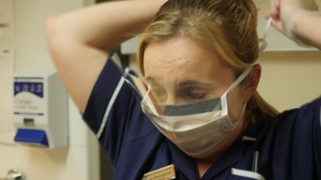 the union that represents nurses has warned that health workers' lives are being put at risk because of a lack of protective equipment the royal... - nhs stock videos & royalty-free footage