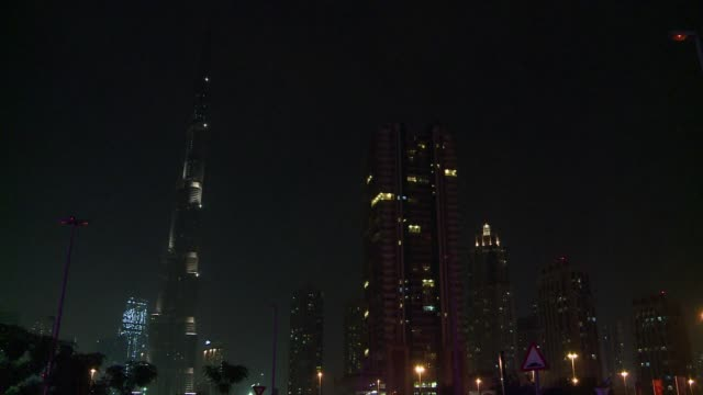 the united arab emirates joined the global movement for earth hour on saturday to raise awareness on the effects of climate change plunging burj... - earth hour stock videos & royalty-free footage
