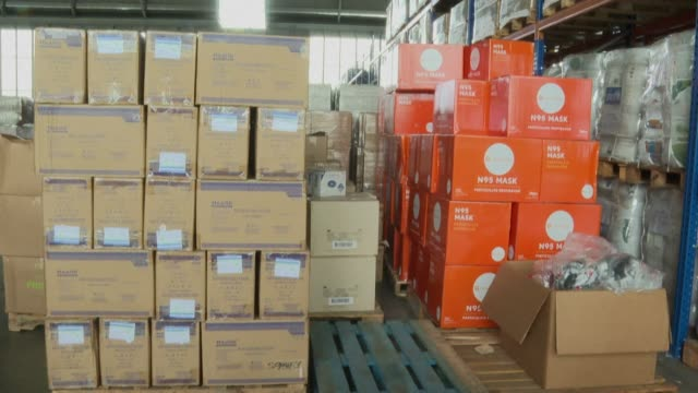 the united nations and the red cross prepare more than 16 tons of supplies, including masks and gloves, for distribution from their collection center... - protective workwear stock-videos und b-roll-filmmaterial