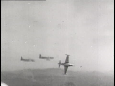 the united nations fighter jets drop bombs over portions of korea. - allied forces stock videos & royalty-free footage