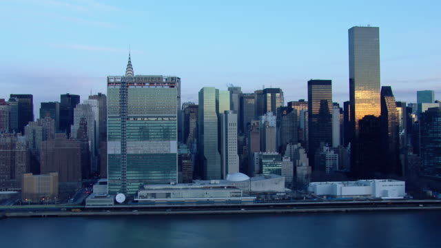 The United Nations Headquarters and the Turtle Bay neighborhood in Manhattan at dawn.