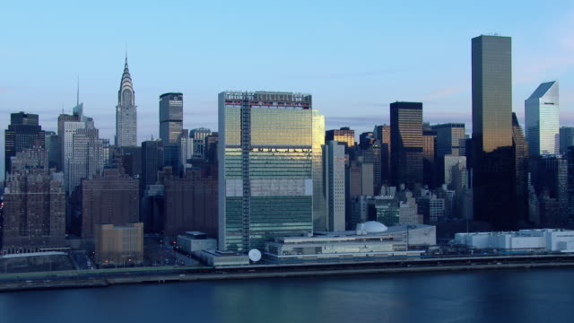 The United Nations Headquarters overlooking the East River at dawn in New York City.