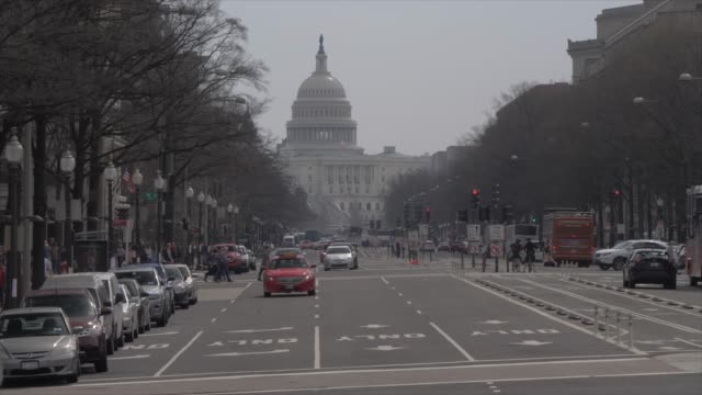 the united states capitol building and traffic on pennsylvania avenue, washington dc, united states of america, north america - capital cities stock videos & royalty-free footage