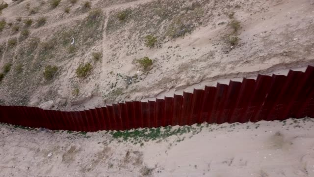 the united states mexico international border wall between sunland park new mexico and puerto anapra, chihuahua mexico - emigration and immigration stock videos & royalty-free footage