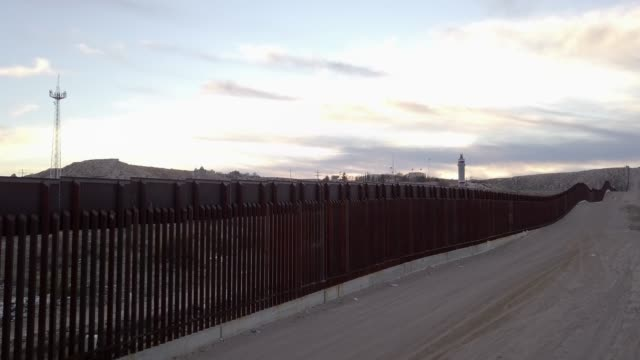 the united states mexico international border wall between sunland park new mexico and puerto anapra, chihuahua mexico - surrounding wall stock videos & royalty-free footage