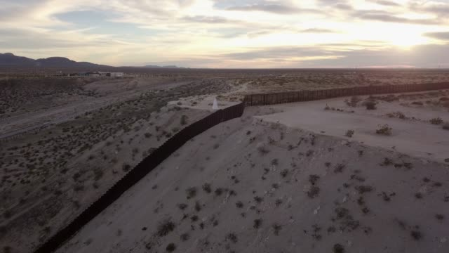 the united states mexico international border wall between sunland park new mexico and puerto anapra, chihuahua mexico - mexican culture stock videos & royalty-free footage