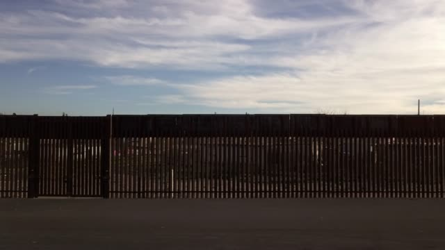 the united states mexico international border wall between sunland park new mexico and puerto anapra, chihuahua mexico - fence stock videos & royalty-free footage