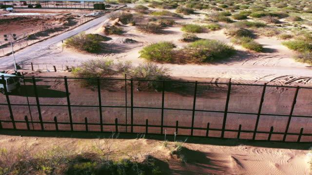 the united states side of the international border wall near the santa teresa border crossing - international border stock videos & royalty-free footage