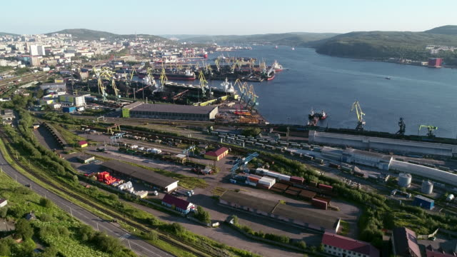 the urban landscape of the murmansk soviet architecture and the bright foliage of summer - unloading stock videos & royalty-free footage