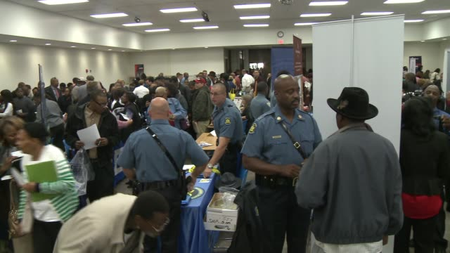 the urban league of metropolitan st. louis hosted a job fair at the st. louis community college-florissant valley campus on sept. 13, 2014. the... - 就職フェア点の映像素材/bロール