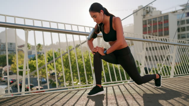 the urban lifestyle is exercising on the streets - lunge stock videos & royalty-free footage