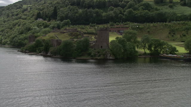 The Urquhart Castle lies on the shoreline of Loch Ness Scotland. Available in HD.