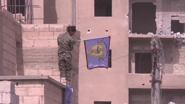 the us backed syrian democratic forces militia was fighting islamic state jihadists in raqa on monday - syrian democratic forces stock videos & royalty-free footage