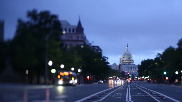 the us capitol building stands at the end of pennsylvania ave before sunrise in washington dc us on wednesday aug 10 shots several wide and similar... - pennsylvania avenue stock videos & royalty-free footage
