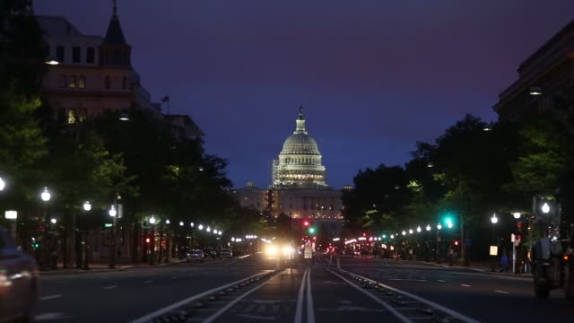 the us capitol building stands at the end of pennsylvania ave before sunrise in washington dc us on wednesday aug 10 shots shot of us capitol... - capitol building stock videos & royalty-free footage