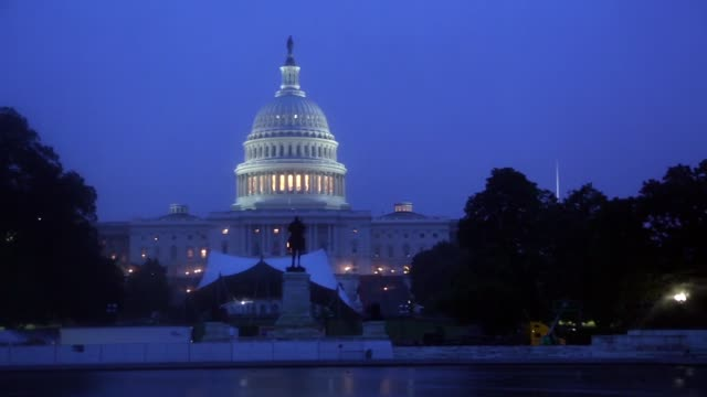 the us capitol building stands behind reflecting pool during a rainstorm before sunrise in washington dc us on thursday july 6 2017 shots full wide... - reflecting pool washington dc stock videos & royalty-free footage