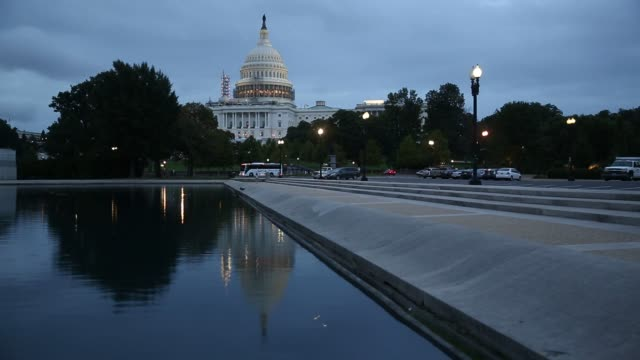 the us capitol building stands near the capitol reflecting pool after sunset in washington, dc, us, on tuesday, aug 9 shots: wide shot of reflecting... - reflecting pool washington dc stock videos & royalty-free footage