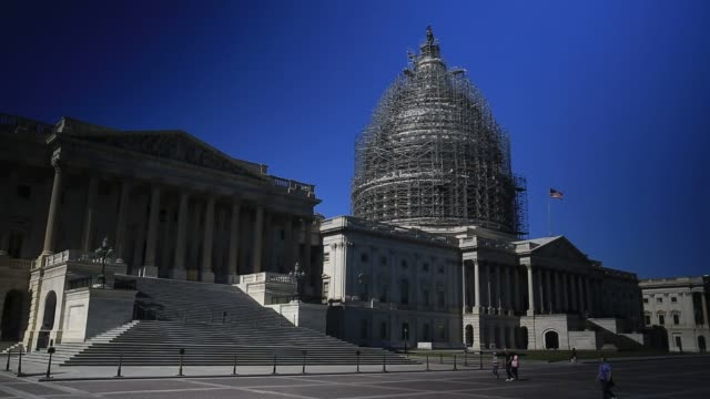 stockvideo's en b-roll-footage met the us capitol building stands surrounded by scaffolding while undergoing restoration in washington dc us on monday oct 12 2015 shots close up shots... - steiger bouwapparatuur