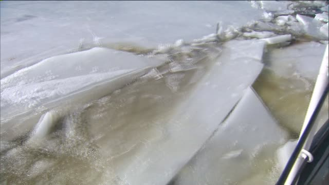 the us coast crew on the uscgc sturgeon bay cuts ice along north of the tappan zee bridge all the way up to albany helping cargo ships transport... - icepick stock videos and b-roll footage
