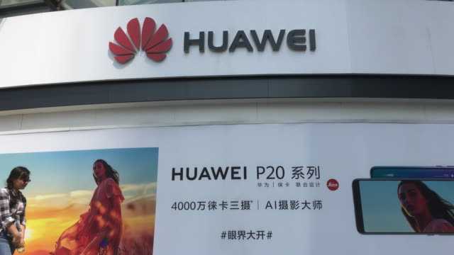 the us government is considering further restricting the activities of of chinese telecom equipment manufacturers such as huawei and zte in the... - flagship store stock videos and b-roll footage