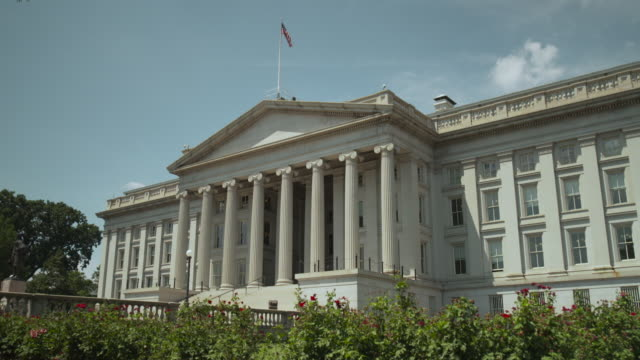 the us national flag flies above the treasury department building, washington, d.c., usa. - capital cities stock videos & royalty-free footage