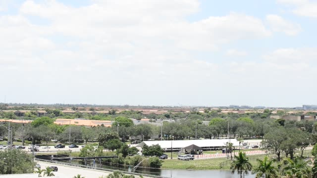 stockvideo's en b-roll-footage met may 08: the u.s. navy blue angels fly over broward county memorial hospital west and c.b. smith park test site for covid-19 on may 08, 2020 in... - pembroke