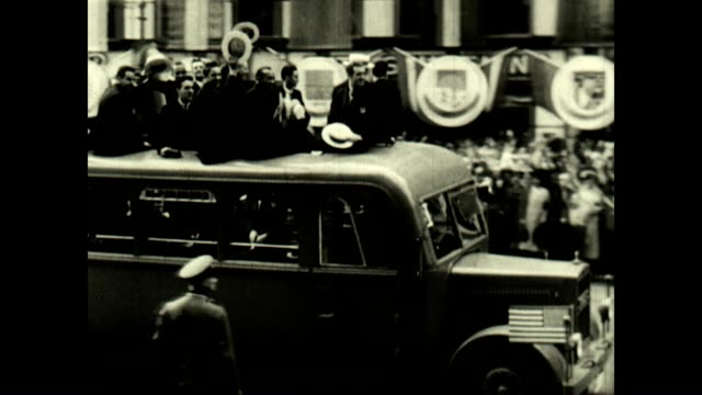The US Olympic Team is transported by bus through Berlin at the 1936 Olympics Jesse Owens a member of the team would go on to win four gold medals