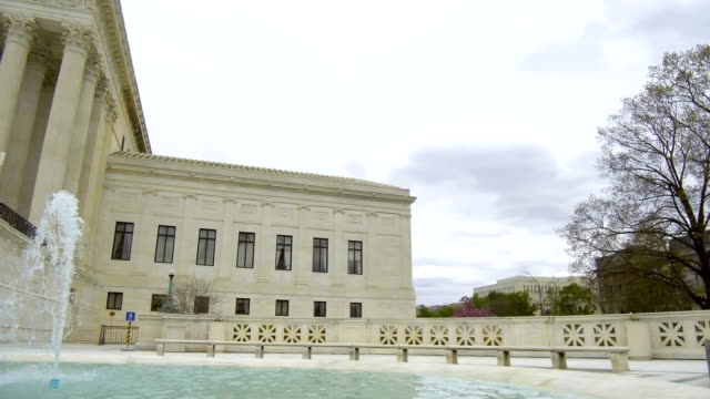 the us supreme court building stands on capitol hill in washington dc us on tuesday april 17 2018 - us supreme court building stock videos and b-roll footage