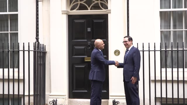 the us treasury secretary steven mnuchin and us economic council director larry kudlow are greeted on the steps of 11 downing street by chancellor... - sajid javid stock videos & royalty-free footage
