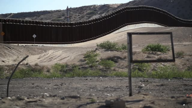 the us/mexico border fence with mexico to the top of the frame is seen on june 19 2018 in el paso texas the trump administration is enforcing a... - frame border stock videos and b-roll footage