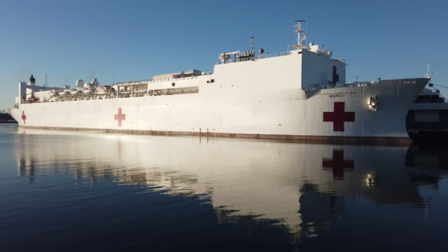 the usns mercy navy hospital ship is docked in the port of los angeles amidst the coronavirus pandemic on april 15, 2020 in san pedro, california.... - port of los angeles stock videos & royalty-free footage