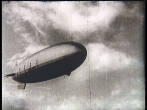 the uss akron moves slowly in a cloudy sky. - airship stock videos & royalty-free footage