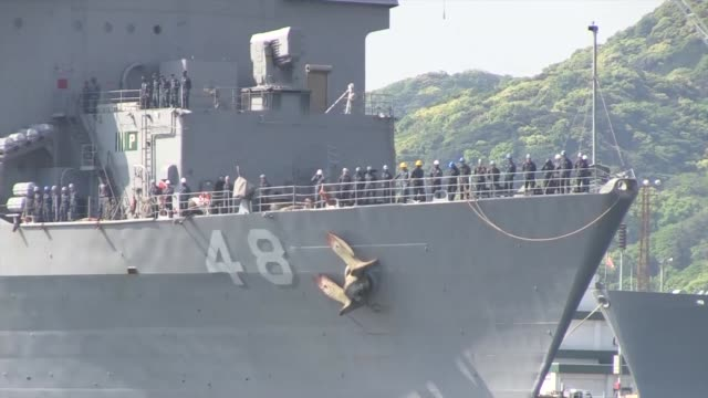the uss ashland returns to sasebo, japan after a two month patrol - ホームカミング点の映像素材/bロール