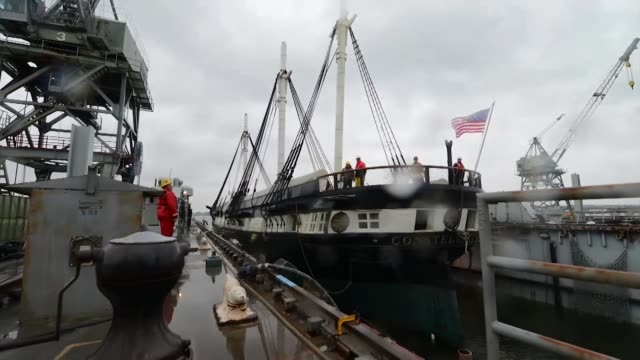 the uss constellation enters drydock at coast guard yard baltimore oct 22 2014 the ship will undergo maintenance and receive repairs to a... - dry dock stock videos & royalty-free footage