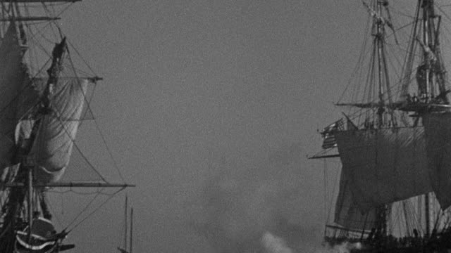 the uss constitution exchanges broadsides with the pirate-captured uss philadelphia in tripoli harbor. - artillery stock videos & royalty-free footage