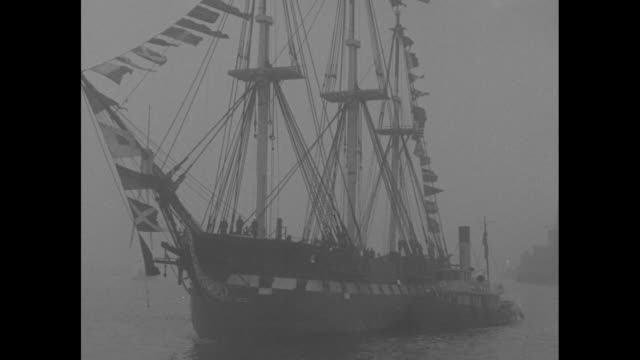 the uss constitution is maneuvered by tugboats through boston harbor with a brief shot of its deck / note exact day not known - uss constitution stock videos and b-roll footage