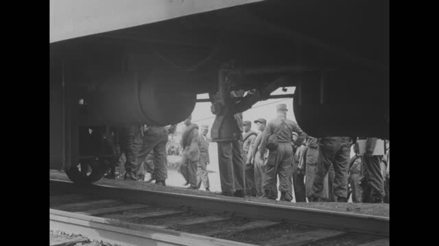 the uss russell county approaches the shore / bedraggled chinese prisoners and a wounded man exit the craft and walk to a passenger car of a train /... - passenger craft stock videos & royalty-free footage