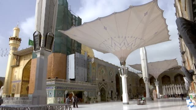 the usually busy central iraqi holy city of najaf is empty amidst the coronavirus covid-19 pandemic - najaf stock videos & royalty-free footage