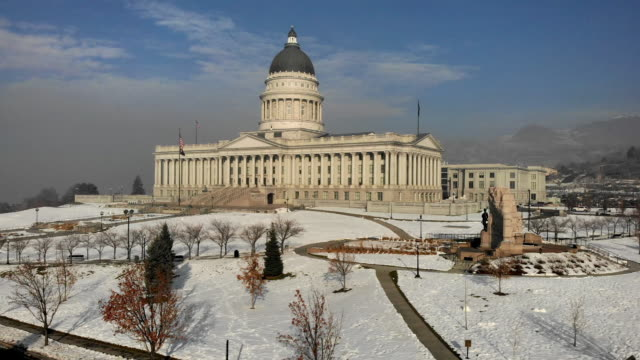the utah state capitol building in salt lake city on a hazy winter morning - utah stock videos & royalty-free footage