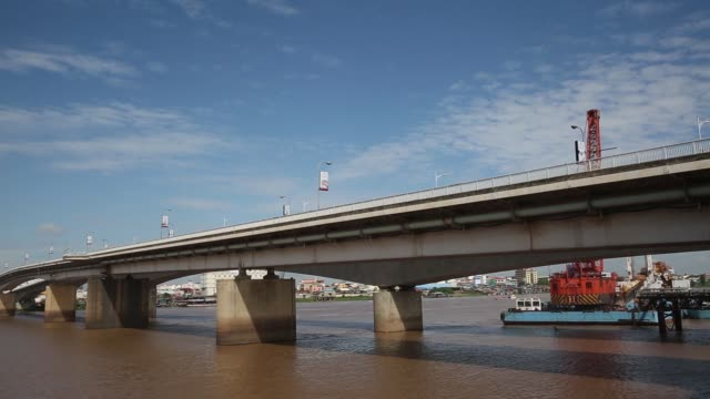 The Vattanac Capital Tower right stands in Phnom Penh Cambodia on Wednesday Sept 13 Buildings stand along the banks of the Tonle Sap river in Phnom...