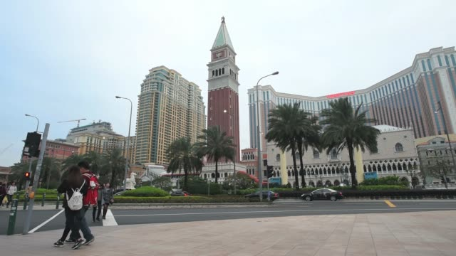 The Venetian Macao resort and casino operated by Sands China Ltd a unit of Las Vegas Sands Corp stands in Macau China on Sunday Dec 6 Pedestrians...