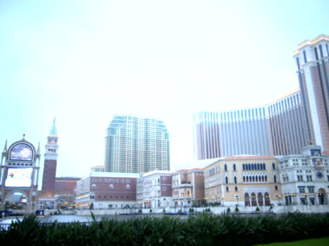 The Venetian Macao ResortHotel skyscraper midrise buildings sign w/ unidentifiable video playing green hedges FG Casino gambling gaming entertainment...