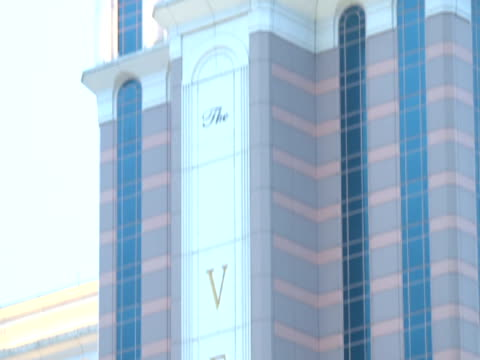 the venetian macao resorthotel skyscraper w/ venetian vertical gold lettering midrise buildings fg casino gambling gaming entertainment luxury... - cotai strip stock videos and b-roll footage