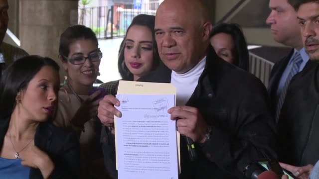 The Venezuelan opposition delivers a request to the National Electoral Council for dates to collect signatures supporting a referendum to remove...