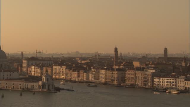 the venice skyline is seen at golden hour. - klocktorn bildbanksvideor och videomaterial från bakom kulisserna