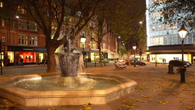 the venus fountain in the centre of sloane square, in autumn, london, uk. - sculpture stock videos and b-roll footage