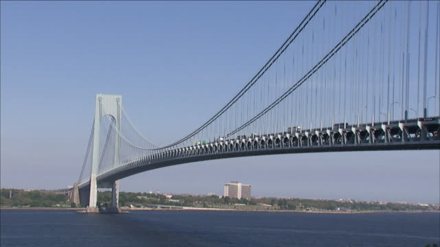 the verrazano bridge spans the narrows between staten island and brooklyn. - narrow stock videos & royalty-free footage